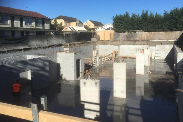 Completion of basement slab for Beaux Apartments